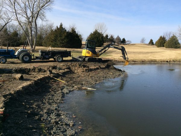All of the soil in front of the excavator was removed to expand the pond size.