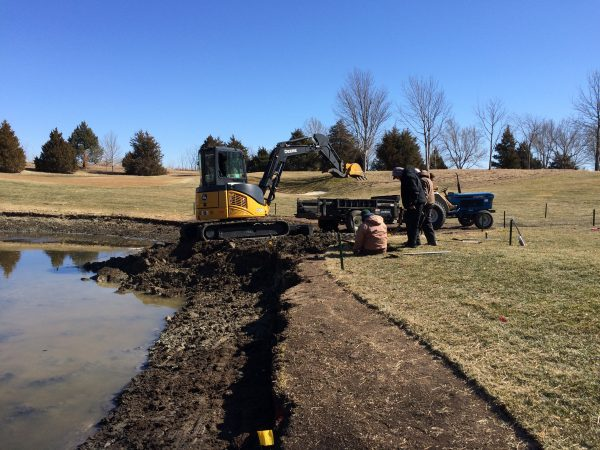 It took several days to remove the dozens of loads necessary to form the new pond shape and slope.
