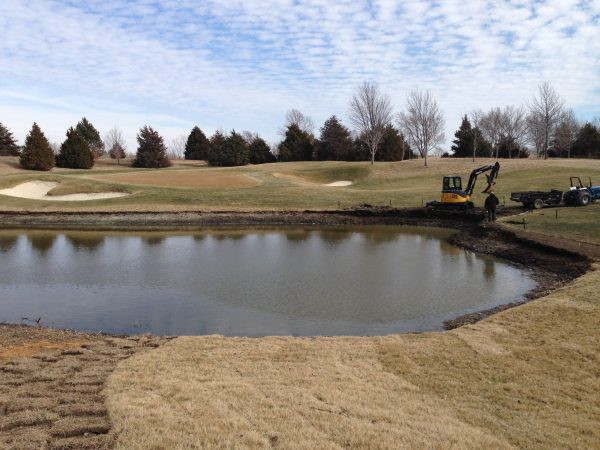 The pond is starting to show it's new shape.  The rough will now be maintained to the water's edge now.